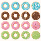 Collection of sixteen glazed colorful donuts with different flav Royalty Free Stock Photos