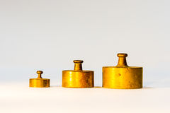Collection of Small Golden Calibration Weights Stock Photography