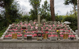 Collection of small tombstones representing children. Kyoto, Japan - September 15, 2016: At the Shinnyo-do Buddhist Temple a collection of small tombstones for Royalty Free Stock Images