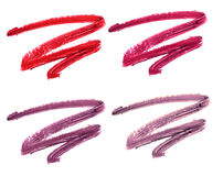 Collection of smudged lipsticks isolated on white. Stock Images