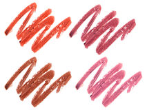 Collection of smudged lipsticks isolated on white. Royalty Free Stock Photography