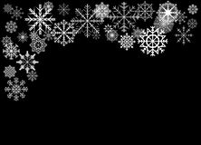 Snowflakes on black background stock photography