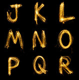 Collection of sparkler firework light alphabet. Collection of sparkler firework light alphabet isolated on black background Royalty Free Stock Photography