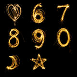 Collection of sparkler firework light alphabet number and sign. Collection of sparkler firework light alphabet number and sign isolated on black background Royalty Free Stock Image