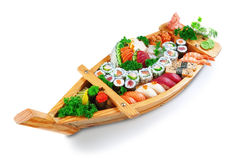 Collection of species sushi on the decorative plate ship. Stock Photos
