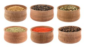 Collection of spices. And herbs in wooden bowls isolated on white background stock photo