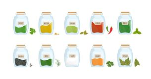 Collection of spices stored in clear closed jars isolated on white background. Bundle of spicy condiments, piquant. Cooking ingredients in transparent kitchen Royalty Free Stock Photos