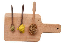Collection of spices on wooden plate isolated (clipping path) Royalty Free Stock Image