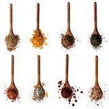 Collection of Spices in Wooden Spoons. Collection of Various Spices in Wooden Spoons: Coriander, Curry Powder, Salt with Herbs, Thyme, Salt with Cayenne Pepper stock images