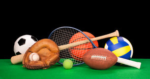 Sports equipment. A collection of sports equipment suck as a football, basketball, baseball, tennin racquet, volleyball, soccer ball and catchers glove with a Stock Photography