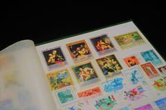 Collection of stamps showed in an album stock photos