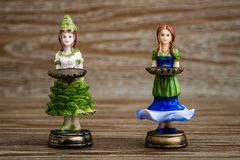 Collection of Statuettes of Girls Holding Tray Royalty Free Stock Photo