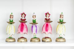 Collection of Statuettes of Girls Holding Tray Stock Photos