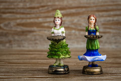 Collection of Statuettes of Girls Holding Tray Royalty Free Stock Image