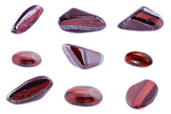 Collection of stone mineral Bull`s Eye Red Tiger`s Eye. Close up Royalty Free Stock Image