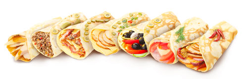 Collection of stuffed crepes. Big collection of elegant,neat, gourmet stuffed crepes decorated with herbs Royalty Free Stock Images