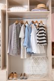 Collection of stylish clothes and shoes in large wardrobe. Closet royalty free stock photos