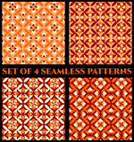 Collection of 4 stylish decorative seamless patterns with geometric ornament of red, orange and white shades. Collection of 4 abstract stylish decorative Royalty Free Stock Image