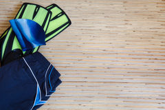 Collection of swimming equipment. Flippers, cap, spilling out of the bag on the background for the school swim team background or competitive swim teams. The royalty free stock image