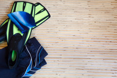 Collection of swimming equipment. Flippers, cap, spilling out of the bag on the background for the school swim team background or competitive swim teams. The royalty free stock photography