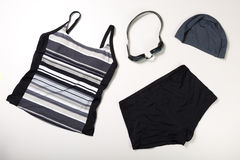 Collection of Swimming suit, caps and glasses Stock Photos