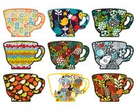 Collection of tea cups with different patterns. Royalty Free Stock Photos
