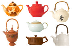 Collection of teapots. Different teapots on the white background royalty free stock images