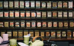 A collection of teas on display in a shop stock photography