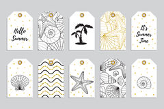 Collection of ten gold gift tags with glitter texture with starfishes and seashells. Stock Images