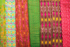 Collection of Thai silk cloths at the weekend market. Royalty Free Stock Images