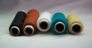 Collection of thread rolls. Collection of yellow,green,white ,red and black thread rolls. DOF provided for black threads Royalty Free Stock Photos