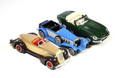 Collection of Three Toy Model Cars on White Stock Image
