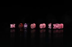 Collection of Tiny Roller Jewels Shining in the Light Stock Photos
