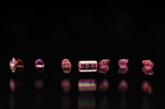 Collection of Tiny Roller Jewels Shining in the Light Royalty Free Stock Image