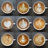 Collection of top view of  latte art coffee mugs. Royalty Free Stock Image