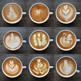 Collection of top view of latte art coffee mugs. Collection of top view of  latte art coffee mugs on timber background Royalty Free Stock Photo
