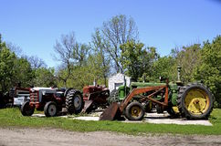 Collection of tractors on concrete pad Royalty Free Stock Photo