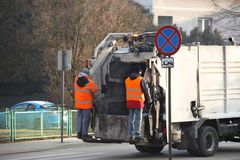 Collection and transportation of domestic garbage by municipal service employees. Control of the ecological situation in cities. stock image