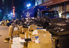 Collection of trash at night in Manhattan. Royalty Free Stock Photos