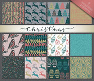 Collection of twelve hand drawn winter holidays seamless patterns Royalty Free Stock Photos