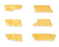 Collection of various adhesive tape pieces on white background. Stock Image