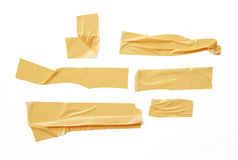 Collection of various adhesive tape pieces on white background. Royalty Free Stock Photos