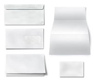 Collection of various blank white paper on white background. Stock Photos