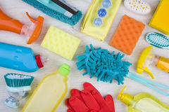 Collection of various colorful household cleaning product on wooden background Royalty Free Stock Image