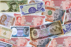 A collection of various currencies from countries. On white background Stock Photos