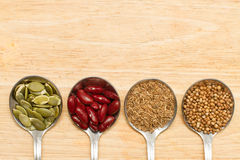 Grains in spoon. Collection of grains in spoon on wooden Royalty Free Stock Images
