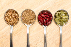 Grains in spoon. Collection of grains in spoon in spoon Stock Photography