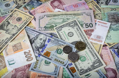 A collection of various foreign currencies from countries spanning the globe. Stock Image