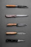 Collection of various kitchen knives on a grey background Stock Image