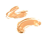 Collection of various make up liquid powder strokes on white background. Royalty Free Stock Images